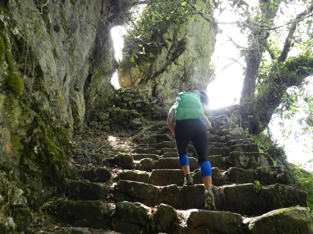 climbing the steps up to one ruins